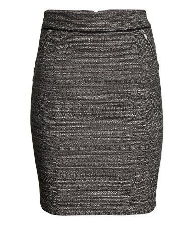 Knee-length skirt in woven fabric with zipped side pockets, and a visible zip at the back. Lined.