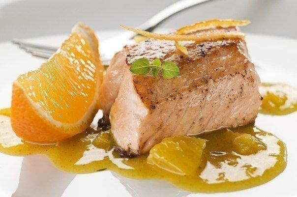 Salmon baked in orange sauce