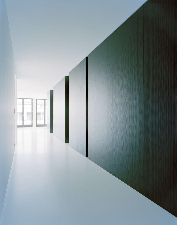 White corridor with dark wall. Designer unknown.