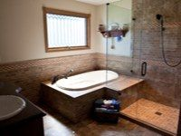 walk-in shower with multiple spray heads and jacuzzi tub