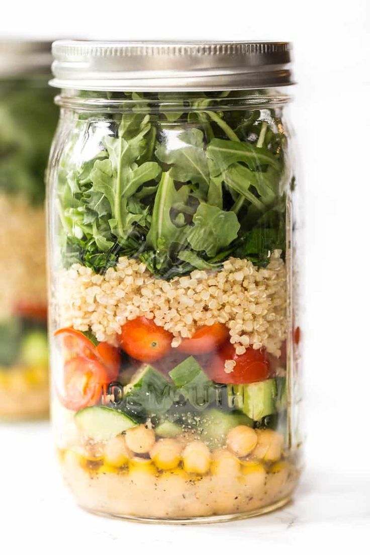 This Chickpea & Quinoa Mason Jar Salad is an easy way to have a healthy lunch at the office! No sogginess, just packed with plant-based proteins and veggies.