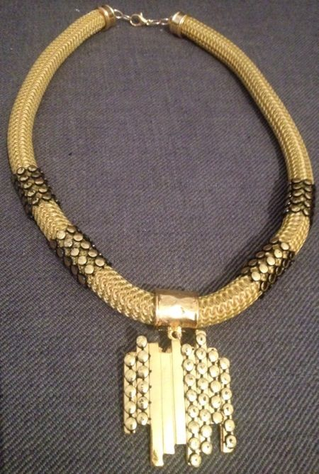 Gold cord necklace with metal chain detail