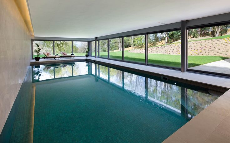 LED concealed in this lighting slot feature the contrast tiles in this pool room.