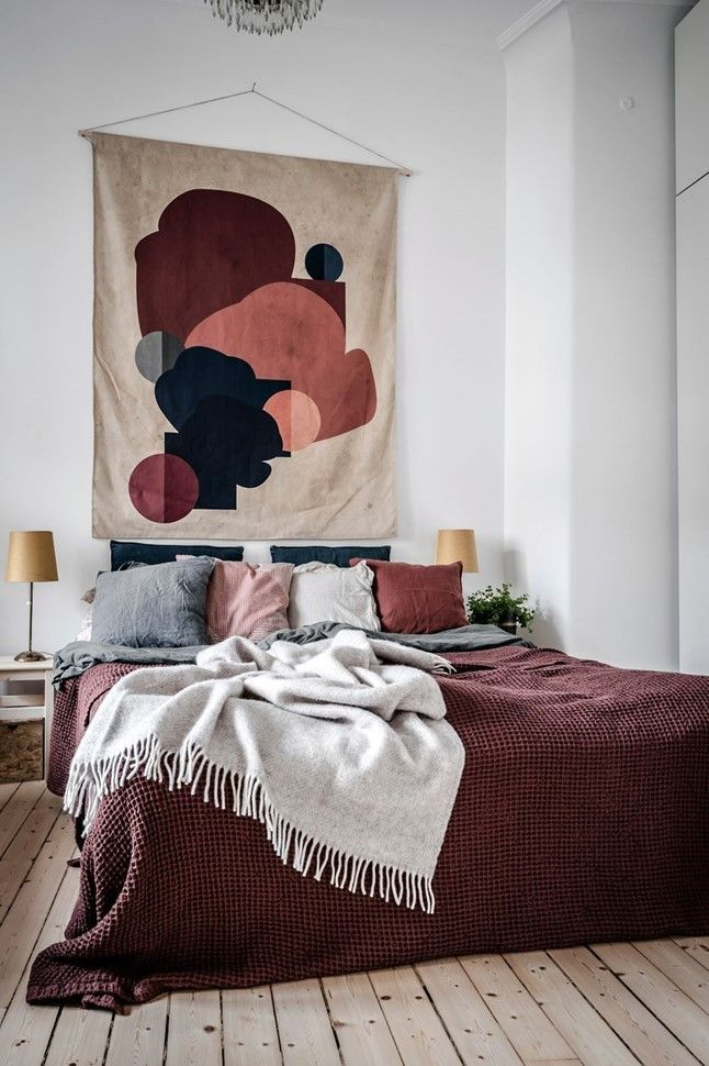 Bedroom With Textile Wall Hanging Featuring Maroon And Peach