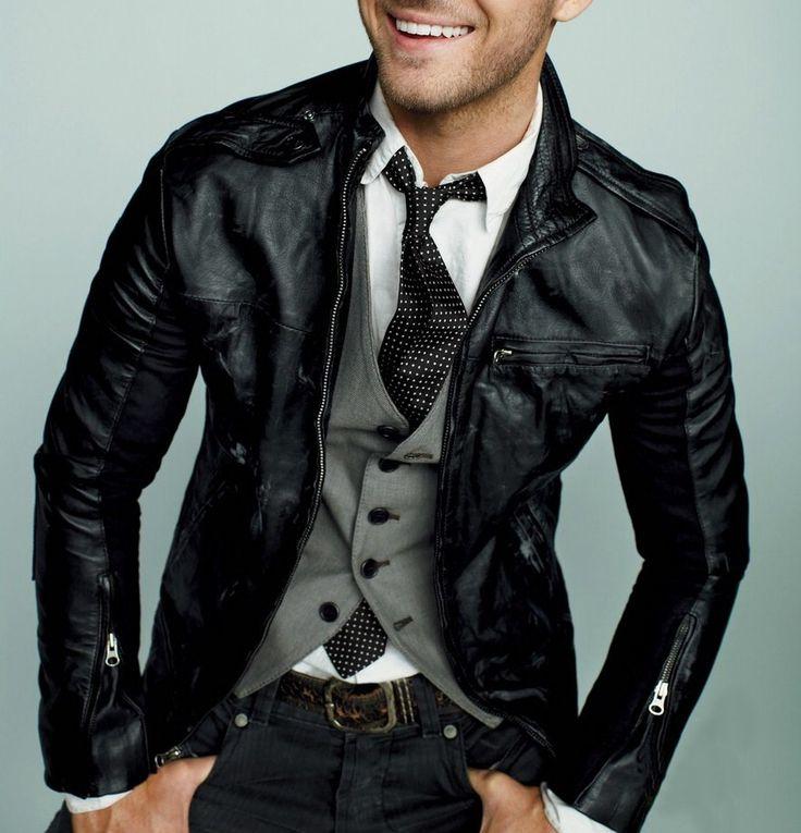White shirt, grey vest, black leather jacket and polka ...