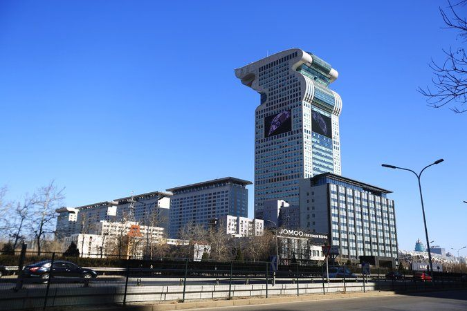 One of Mr. Guo's properties, the torch-shaped Pangu Plaza, is next to Beijing's Olympic Green. It was a landmark during the 2008 Summer Games. Credit Associated Press