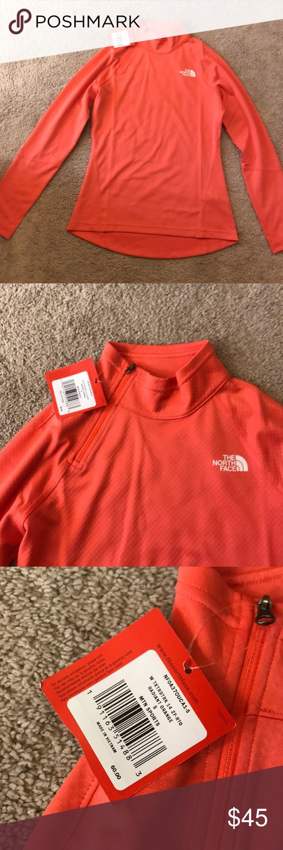 NWT north face neon orange asymmetrical 1/4 zip NWT flash dry women's cut asymmetrical side neck 1/4 zip bright orange zip up.  Super pretty color! Size small.  Smoke free home. North Face Tops