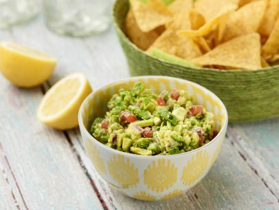 Ina's guacamole is the ideal dip to bring to a party. The other guests will thank you when they taste the lemony, garlicky flavor of this 5-star recipe.