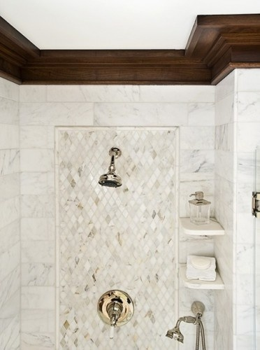 shelves instead of niche?  First NO gold or brass but regardless the shelves and marble/tile design are very nice