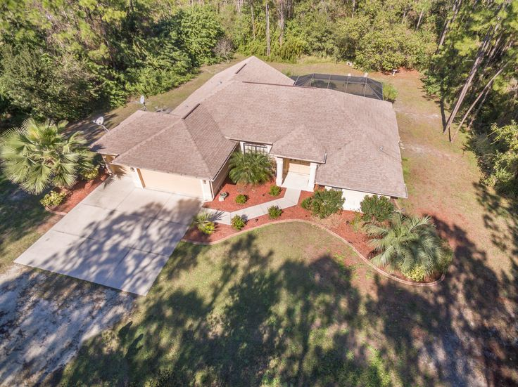 Spectacular Country Charmer Multi-level Pool home with 3 bedrooms, 2 full baths & 3 car garage in the North Port Estates! Horse Country!