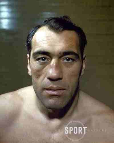 "Primo Carnera - the former tallest heavyweight boxing champion in the world at 6'7"" (billed as 6'9""), before modern champion, 6'11"" Nikolai Valuev. Carnera's reign was ended by Max Baer."