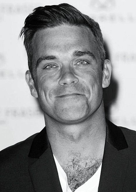Robbie Williams - great performer!! And cute too! :)