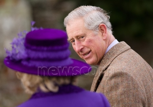 Prince Charles smiles at wife Camilla as they walk to Christmas church services 2012