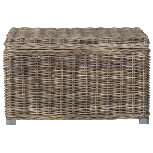 Inspired by a vintage European design, this transitional storage trunk features a casual mix of natural kubu rattan and mahogany and handles for portability. Crafted by master weavers, the rattan texture is ideal for rustic, coastal and casual settings.