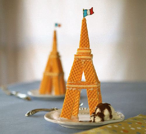 Wafer cookie Eiffel towers....so cute, possibly something the kids could make at the party.