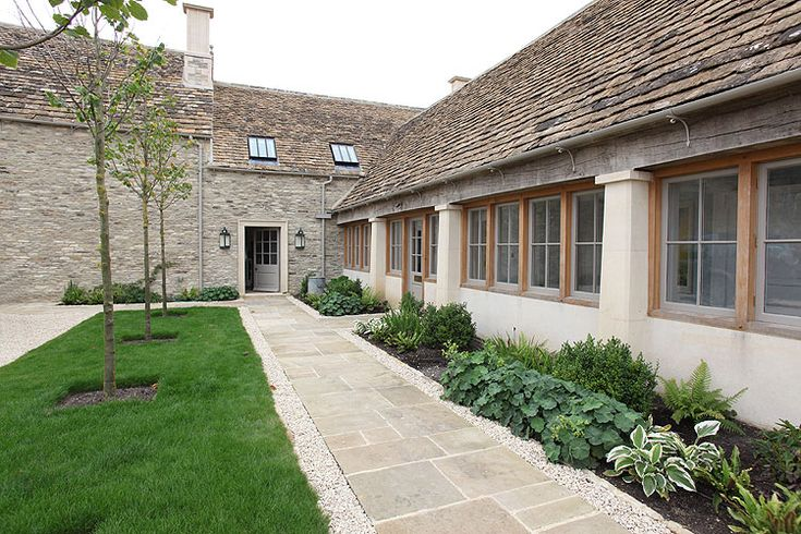 Love the muted colors and the stone lined paver path