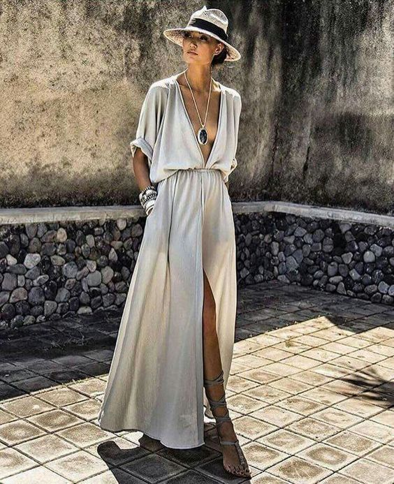 Hello to my new favorite maxi! It has a unique drop sleeves to swoon about. Flowing bodice and a high slit keep this maxi breezy and flattering. Complete the look with a panama hat!