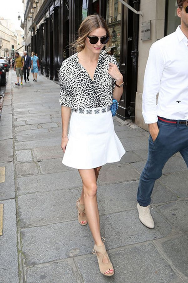 Olivia Palermo wearing a white skirt and printed top. We just love her street style! #fashion