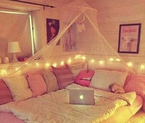 Gorgeous!! I have a tent like that over my bed, but how cute would that be as a movie corner in the living room?? :)