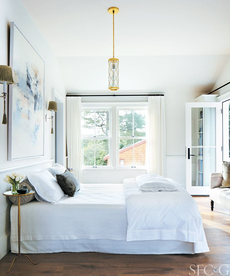 White bedroom with gold accents
