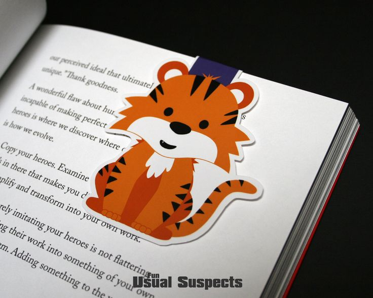 Orange and black is where it's at! Charley the Tiger is ferociously cute and tenaciously loyal. He'll hang around, protecting your pages, for as long as you need him. This star in stripes will be your