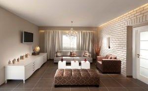 Das Wohnzimmer hat weiß lackierte Backstein-Mauer, die einen schönen Kontrast zu der Farbe der Fliesen. Foto von Elad Gonen