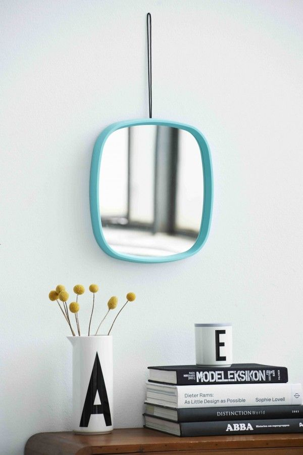 Television mirror in turquoise. Also available in grey. For the hallway, the bathroom or kids room. Flowers in Aqua jug.