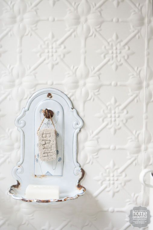 The pressed-metal sheets on the walls are a budget-friendly option that deliver a vintage vibe.