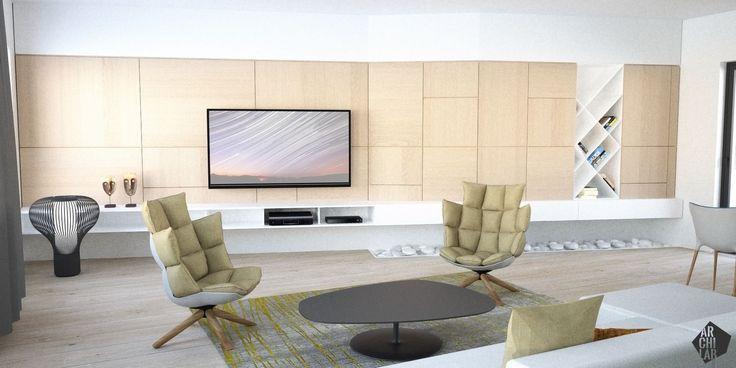 Striktne lineárna obývačková stena je len jemne zalomená, aby nekonkurovala ostatným výrazným detailom v miestnosti.