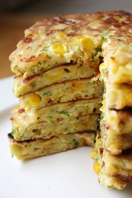 zucchini corn cakes In large bowl, combine 4 large eggs, beaten, 1/4 c olive oil, 2 tsp salt, 1/2 tsp ground pepper, 1 tsp dried basil, 1 tsp dried oregano - whisk. Add 3 c grated zucchini (about 1 large zucchini),1 c corn 1 c shredded cheddar cheese - stir thoroughly. Add 1 3/4 c  flour; stir until combined. Heat skillet or griddle to med-high heat, add small amount of oil. scoop 1/4 c of batter onto the skillet into 4in circle. Cook each side 3-4 minutes, or til golden brown.