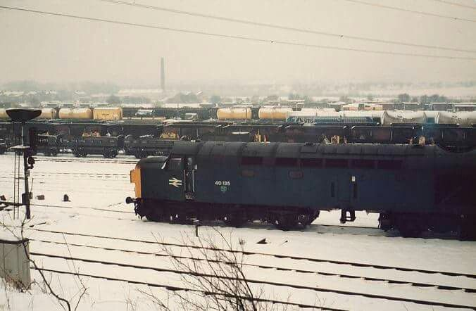 With its looks spoilt by the missing boiler water tanks..40135 awaits its next duty at Healey Mills..26/1/84..