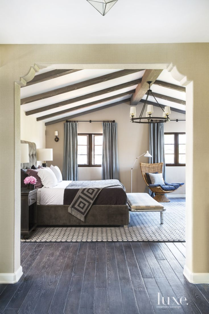 Spanish Colonial Neutral Bedroom With Vintage Bench