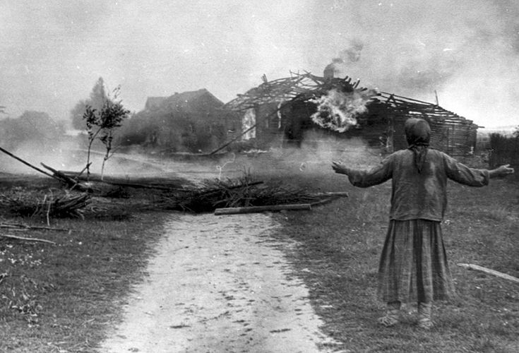 A Russian woman watches building burn sometime in 1942.