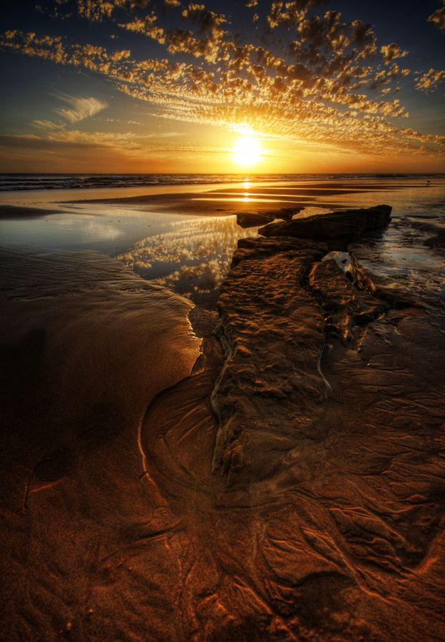 Low tide at Point Lonsdale (Victoria, Australia) reveal the rocky coastline that lies beneath the water.