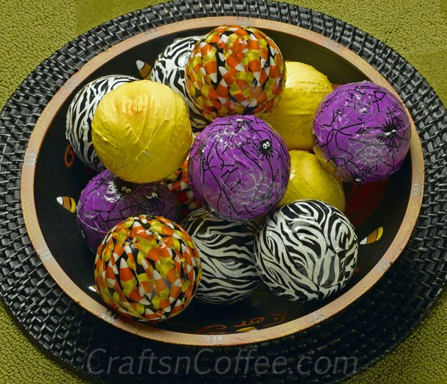 DIY-Duct-Tape-Deco-Spheres. Easy idea to use that cute, Halloween duct tape. Just wrap your strips around Styrofoam balls. #DuctTapeCrafts