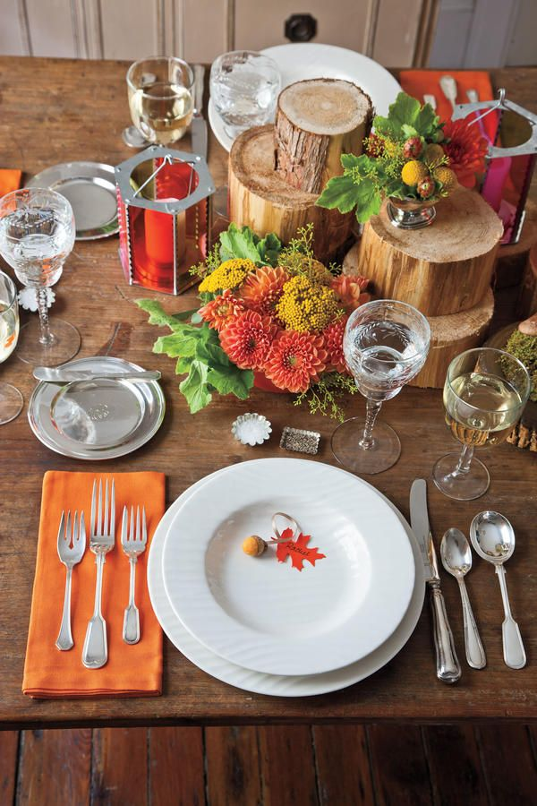 Natural Tablescape - Fabulous Fall Decorating Ideas - Southernliving. Simple white plates paired with timeless flatware and thin stemware keep this more rustic setting looking elegant. Bold orange napkins give the setting a pop of seasonal color.