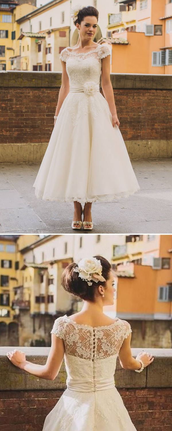 For a classic, timeless wedding dress, wear a tea-length dress with lace details.