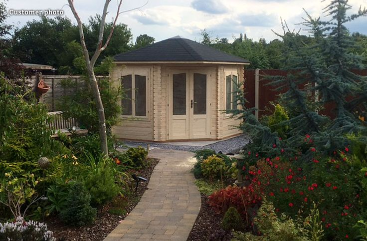 Customer photo of a lovely garden path leading to a Melanie (6.8 sqm) corner summer house: http://www.gardenlifelogcabins.co.uk/products/melanie68/product-details.php