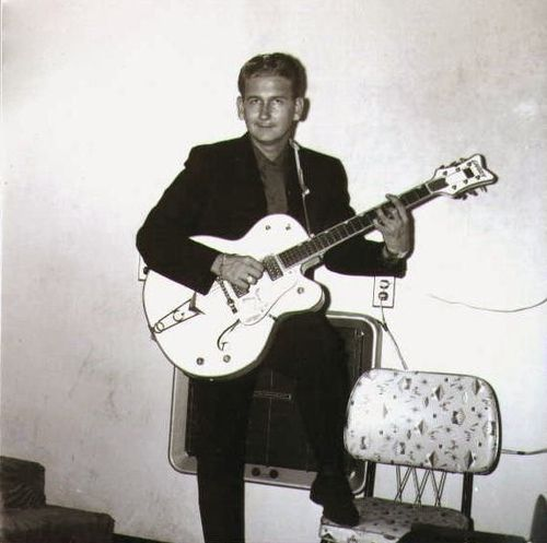 A very young Roy Orbison, 1956 (without the dark glasses and dyed black hair)..Note the Gretsch White Falcon guitar.