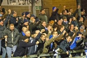 Wealdstone fans celebrate a goal against Dartford
