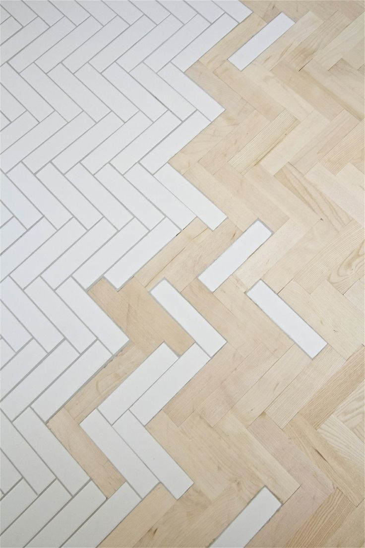 It's All in the Details: Beautiful Flooring Transitions We Can't Get Enough Of - Tile pavers playfully transition to wood in this bathroom from Kalb Lempereur.