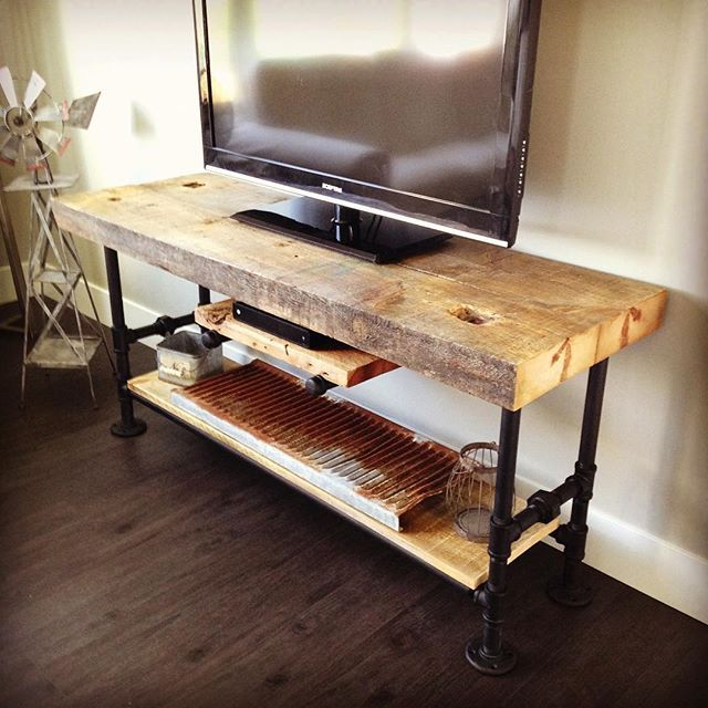The TV stand that my husband made turned out awesome! #pipefurniture #roughhewn #picoftheday