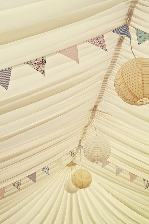pretty pastel bunting in a marquee - Read more on One Fab Day: http://onefabday.com/durhamstown-castle-wedding-by-bronte-photoraphy/