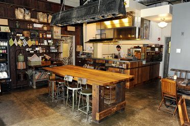 The dining room with open kitchen at Artifact Coffee.