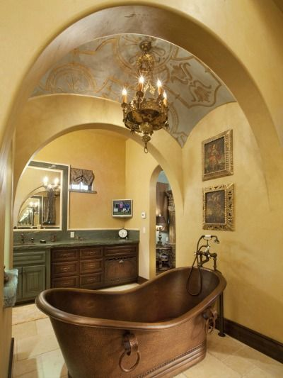 Bathroom Remodeling Must-Haves -- Copper bathtub, vaulted ceiling, and gold chandelier