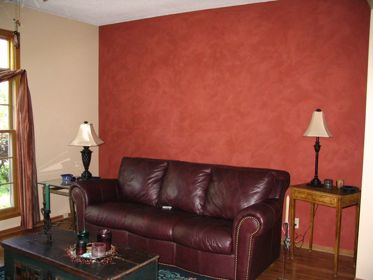 I used behr eggshell classic taupe as a main color with an Classic red paint color