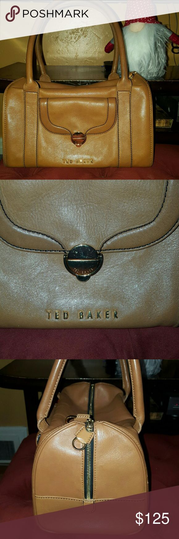Camel Ted Baker Leather Handbag Satchel Gorgeous handbag from Ted Baker of London. Preloved condition. Some minor scratches. Some scratches on gold hardware. Handles are a bit darker from use. Inside has signature bulldog lining. No stains or spots. Whole bag has been professionally cleaned inside and out. Smoke free, pet free home. Ted Baker Bags