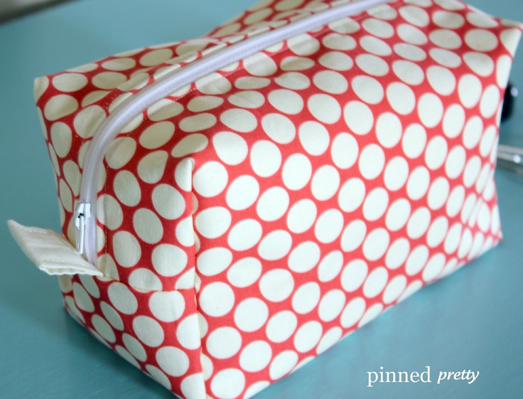 Large Makeup and Cosmetic Bag in Lotus Full Moon Polka Dot Cherry by Amy Butler. $20.50, via Etsy.:
