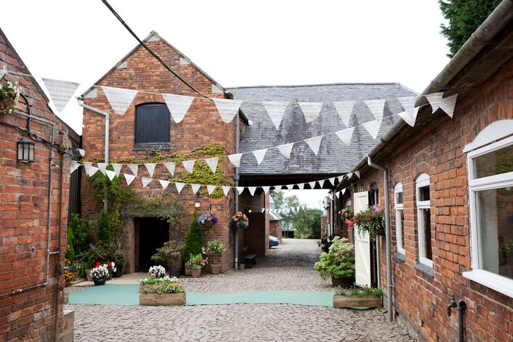 Halstead House with renovated barn (The Opera House) in Leicestershire -  Image by Ali Lovegrove Photography - A wedding at Halstead House with a pink and grey colour scheme and the groom wearing Ted Baker with photography by Ali Lovegrove Photography