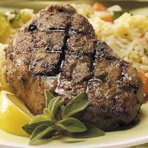 "Greek Pork Chops Recipe -""My in-laws taught me a lot about cooking, so any time I come across a great new recipe, I enjoy making it for them,"" says Geri Lipczynski of Oak Lawn, Illinois. ""These tasty grilled chops always get rave reviews."""